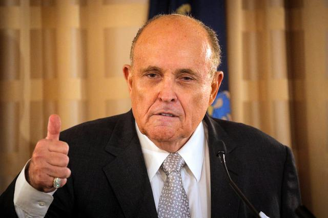 FILE PHOTO: Rudy Giuliani, former New York City Mayor and personal attorney to U.S. President Donald Trump, speaks during a news conference to promote Republican Party candidates in New York City, U.S., September 16, 2020. REUTERS/Brendan McDermid