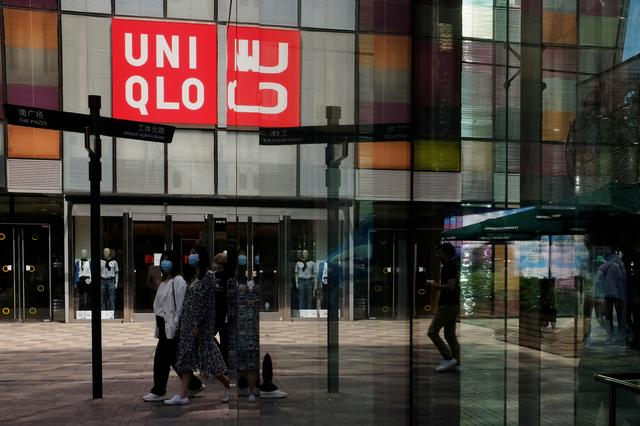 FILE PHOTO: Fast Retailing's fashion chain Uniqlo, at a shopping complex in Beijing, China May 24, 2020. REUTERS/Florence Lo/File Photo