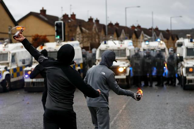 Rioters throw burning bottles at the police on the Springfield Road as protests continue in Belfast, Northern Ireland April 8, 2021. REUTERS/Jason Cairnduff