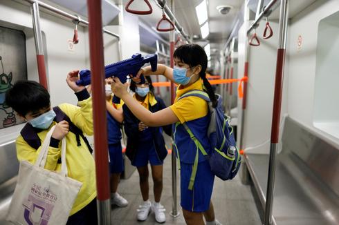 Hong Kong marks security 'education day' with military march and toy guns for kids
