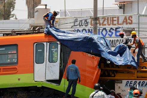 Mexico City rail overpass collapses onto road