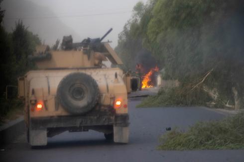 Afghan commandos battle Taliban insurgents