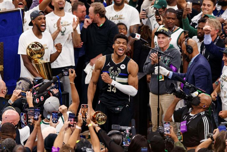 Milwaukee Bucks forward Giannis Antetokounmpo celebrates with the MVP Trophy following game six of the NBA Finals against the Phoenix Suns in Milwaukee, Wisconsin, July 20, 2021. Jeff Hanisch-USA TODAY Sports