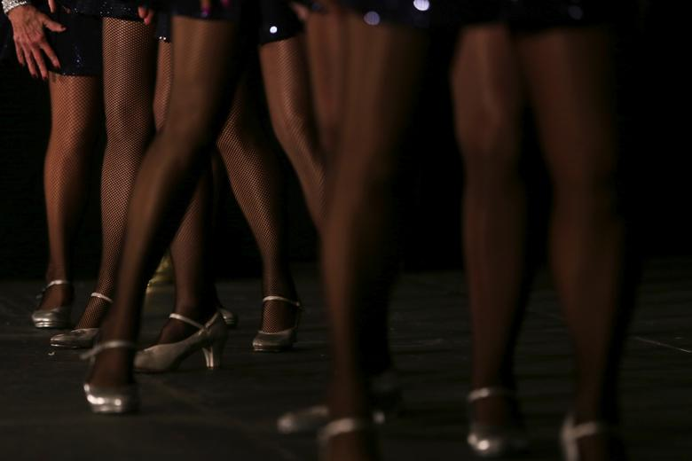 """Members of the 2021 Ms. Texas Senior America Pageant Board tap dance to """"Proud to Be an American"""". REUTERS/Shelby Tauber"""