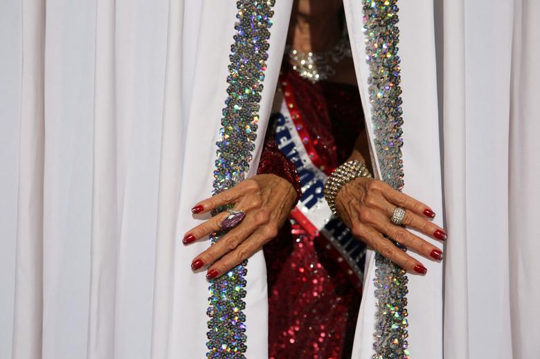 Debbie Carroll Boyce, Ms. Senior America 2011, pulls back the curtains on the stage at the Ms. Texas Senior America Pageant in Dallas, Texas, July 24, 2021. REUTERS/Shelby Tauber