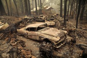 Swarming Dixie Fire incinerates swaths of northern California