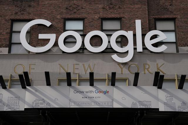 FILE PHOTO: FILE PHOTO: A Google sign is pictured on a Google building in the Manhattan borough of New York City, New York, U.S., October 20, 2020. REUTERS/Carlo Allegri/File Photo