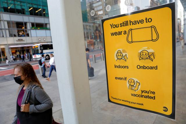 A poster alerting for the wearing of masks is seen on a 42nd Street subway entrance as cases of the infectious coronavirus Delta variant continue to rise in New York City, New York, U.S., August 2, 2021. REUTERS/Andrew Kelly