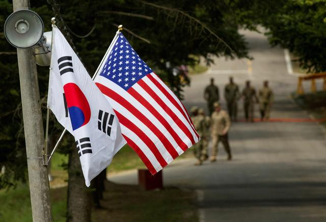 FILE PHOTO: The South Korean and American flags fly next to each other at Yongin, South Korea, August 23, 2016.  Courtesy Ken Scar/U.S. Army/Handout via REUTERS
