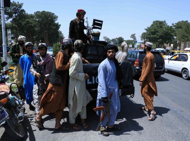 Taliban forces patrol a street in Herat, Afghanistan August 14, 2021. REUTERS/Stringer