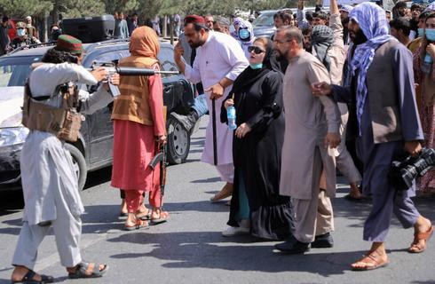 In pictures: Taliban fire in air to scatter hundreds of protesters in Kabul