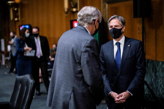 U.S. Secretary of State Antony Blinken speaks with Senator Jeff Merkley (D-OR) before a Senate Foreign Relations Committee hearing to examine the United States' withdrawal from Afghanistan on Capitol Hill, in Washington, U.S., September 14, 2021. Jabin Botsford/Pool via REUTERS