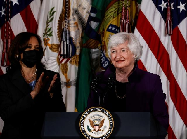 U.S. Vice President Kamala Harris applauds Treasury Secretary Janet Yellen as they discuss a new report on childcare and the U.S. economy during an unveiling of the report at the Treasury Department in Washington, U.S., September 15, 2021. REUTERS/Carlos Barria