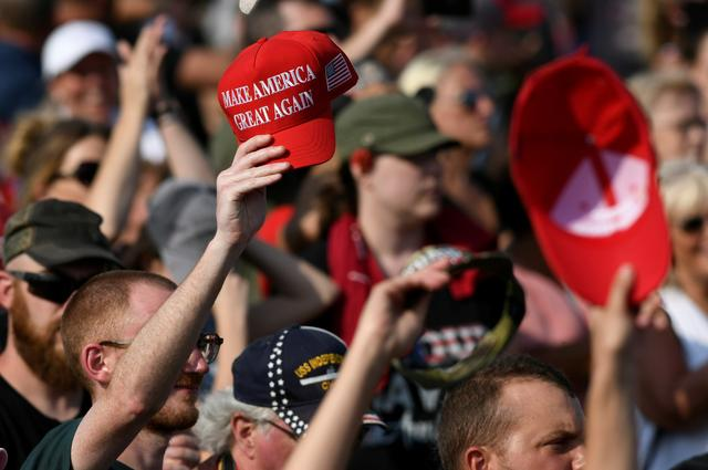 FILE PHOTO: Supporters of former U.S. President Trump attend his first post-presidency campaign rally at the Lorain County Fairgrounds in Wellington, Ohio, U.S., June 26, 2021. REUTERS/Gaelen Morse