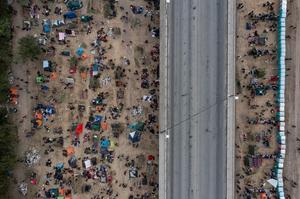 Over 15,000 migrants desperately seek shelter under Texas border bridge