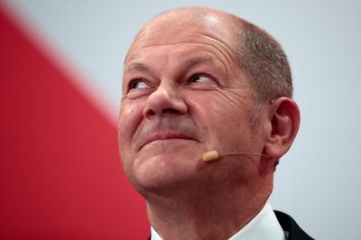 Germany's Social Democrats beat conservatives in vote to decide Merkel successor