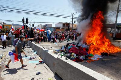 Venezuelan migrants in Chile's north fearful after fiery anti-immigration protests