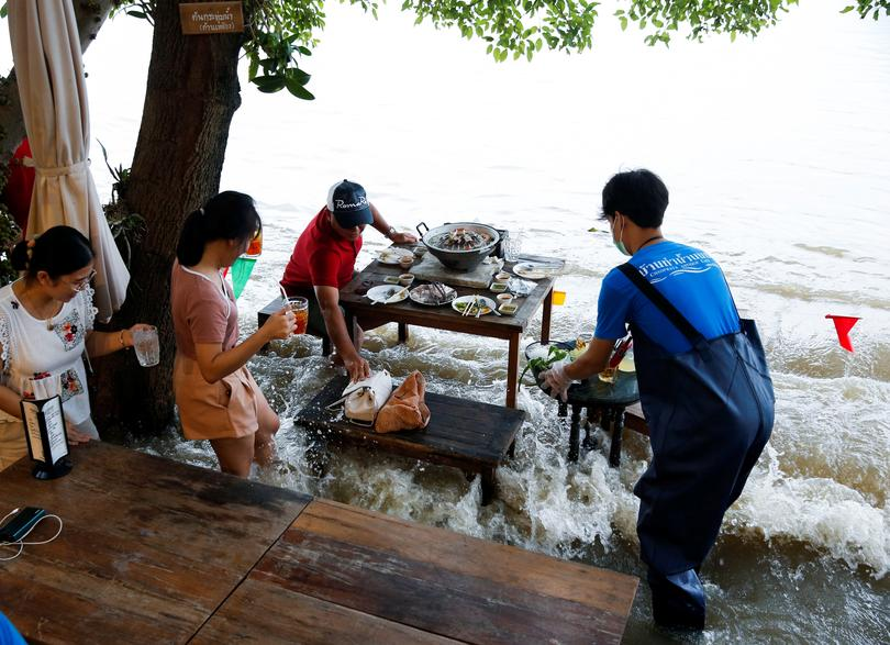 Beware the crashing waves at riverside restaurant in Thailand | Pictures - Reuters India