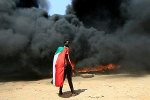 In pictures: Gunfire, protests as Sudan's military seizes power in coup