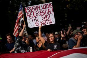 Hundreds protest vaccine mandate outside New York City Hall